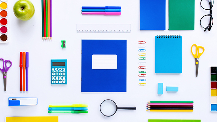 School supplies on a white background. Flat lay, top view