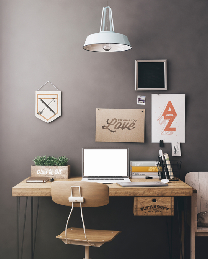 Stylish workspace with computer and posters on home or studio